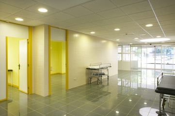 Modern hospital emergency entrance in yelow tone