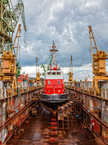 Reparation Fire-boat in large floating dry dock. - 64711092