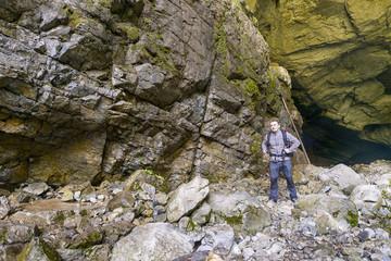 tourist man passes a stone mountain