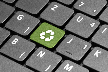 Recycling. Green hot key on computer keyboard.