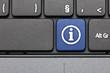 Information. Blue hot key on computer keyboard.