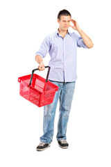 Guy holding an empty shopping basket