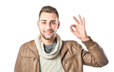 Man making an OK gesture over isolated white background