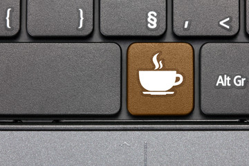 Coffee break. Brown hot key on computer keyboard.