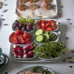Radishes and watercress on table with other buffet ingredients.