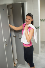 Woman standing by locker in changing room