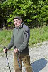 The senior man by nordic walking