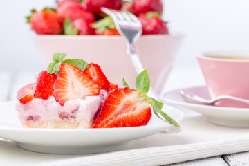 Strawberry cake with coffee or tea.