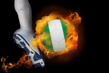 Football player kicking flaming nigeria ball