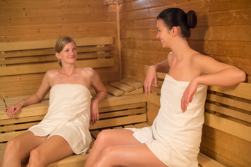 Two women talking in the sauna