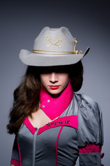 Woman cowgirl with gun in studio