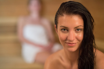 Smiling sweaty woman in the sauna