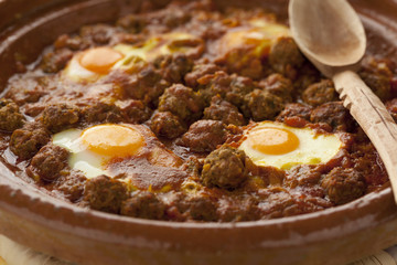 Moroccan kefta tagine with eggs (Mkaouara)
