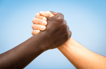 Black and white human hands - Handshake against racism
