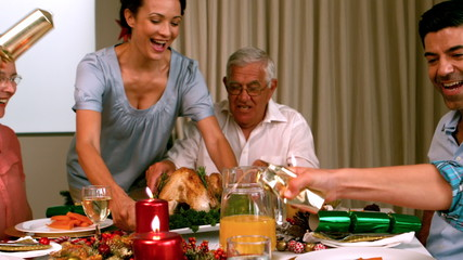 Family having christmas dinner at home