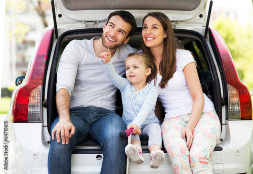 Happy family sitting in the car - 64718615