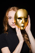 Redhead woman iwith mask in hypocrisy consept against black  bac