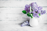 Fototapety Lilacs in white vase on rustic background
