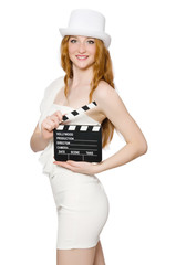 Young woman with movie board on white