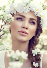 Portrait of young beautiful woman in the garden