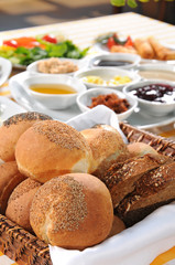 Bread basket on tasty breakfast table