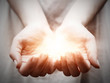 The light in young woman hands. Sharing, giving, protection - 64722495