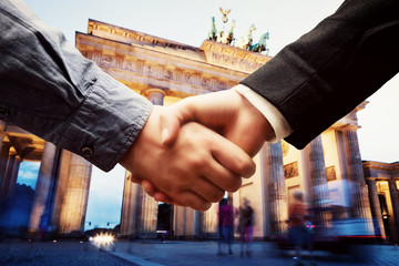 Business in Berlin. Handshake on Brandenburg Gate