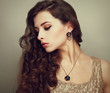 Beautiful profile of female model looking with long curly hair