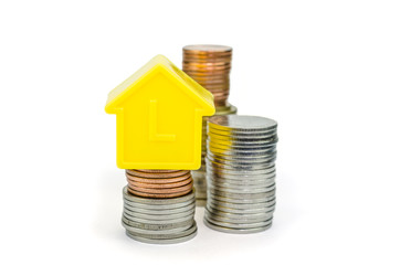 a model home and coins