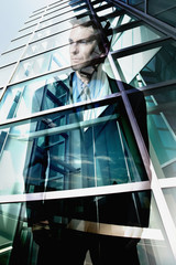 Reflection of businessman in office windows