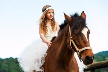Cute girl riding horse.