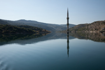 submerged minaret reflected in the Euphrates