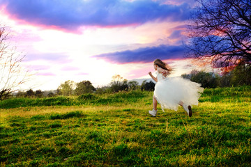 Girl wearing white dress running.