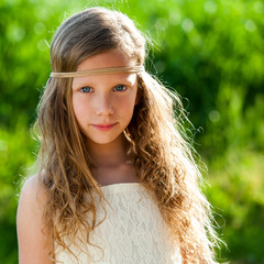 Portrait of cute girl wearing ribbon headband.