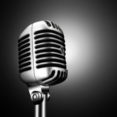 retro microphone over black background
