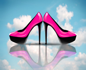 Pair of pink high heel shoes, on sky with clouds background
