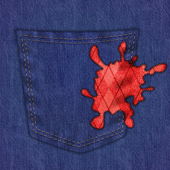 Close up denim pants with red fabric stain
