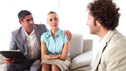 Couple talking to their financial advisor