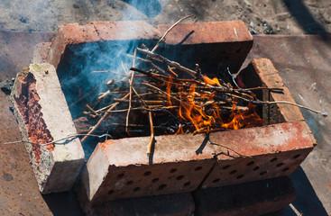 evening bonfire with smoke