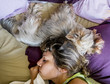 A girl sleeps together with a dog in the bed