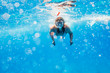Girl swims with a mask underwater in the sea
