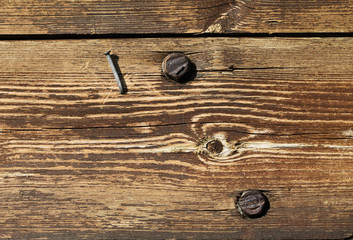 Old wood with nail and screws