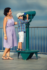 Mother and son looking through binoculars