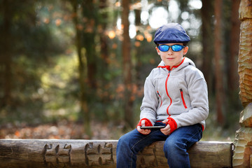 Portrait of little boy sitting on a bench