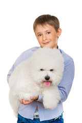 Boy with a dog breed bichon