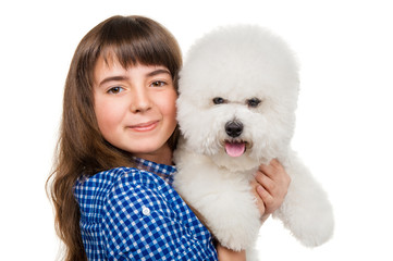 Girl with a dog breed bichon