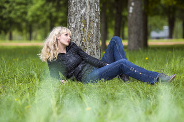 Girl has a rest in wood