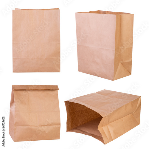 Brown paper bags isolated on white background - 64729603