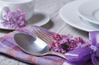 Elegant table setting for breakfast, with flowers lilacs