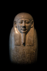 Granite sarcophage of Egyptian pharaoh in black background